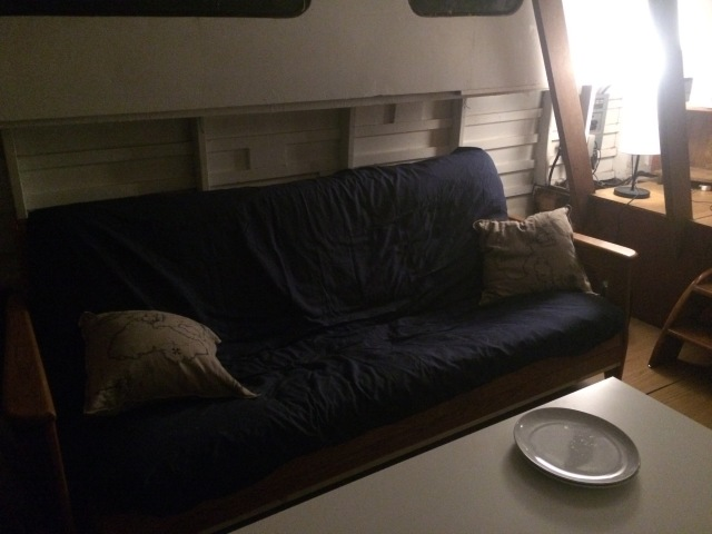 Our new-to-us futon - multi-use items are essential on a boat